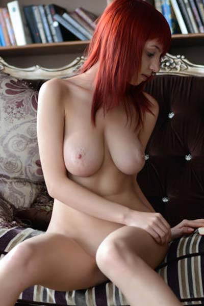 Stunning redhead Yilka has the brains and the curves