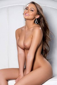 Playboy Alluring busty brunette Deanna Greene steps in the nude and flaunts her curves