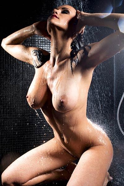Fantastic busty brunette Manja Dobrilovic bares her amazing body and poses sensually