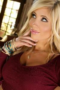 Breathtaking blonde Tasha Reign seduces her man with hot striptease