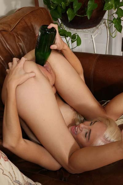 Provocative Naomi Woods sticks the bottle up her wet pussy
