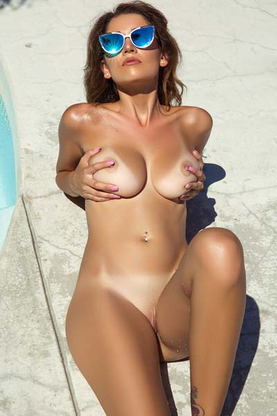 Poolside seduction by busty and exotic Ali Rose