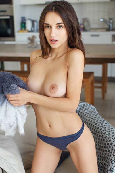 Gloria Sol loves to flaunt her enticing assets lying naked on the couch