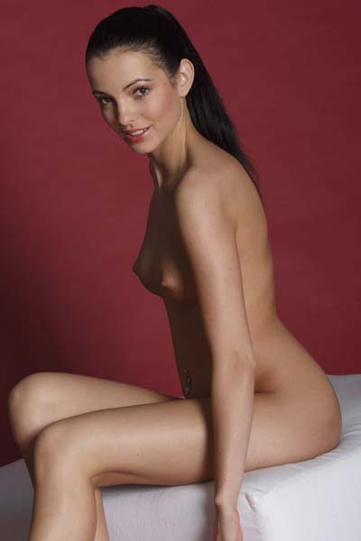 Sapphira A gets her sweet muff exposed as she poses sensually for the camera