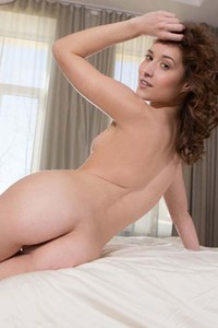 Medina V shows us her sexy attributes erotically on the bed