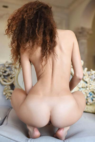 Maxine T steps in the nude and shows all of her assets for the camera