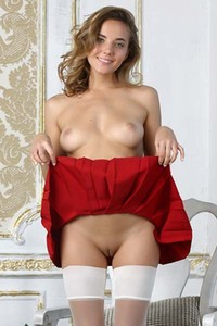 Busty goddess in tight white stockings Katya Clover playfully showcases her irresistible curves