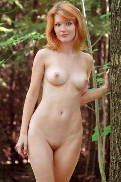 Mia Sollis steps in the woods and presents her curvy naked body outdoors