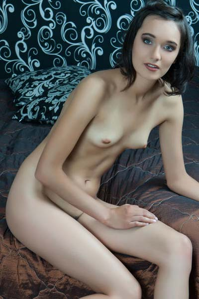 Lovely perky babe Chandra exposes and flaunts her tight hairy pussy erotically