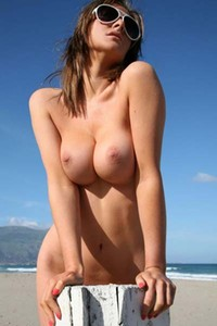 Charming cutie pie Jenna Jones loves to get naked on the beach and show her beautiful boobs