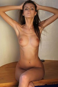 Hot busty beauty Barbara exposes her fabulous curves and teases erotically