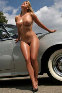 Caterina Hovorkova exposes her fabulous curves by an old timer