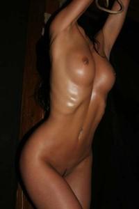 Kinky Lex showcases her curvy body playfully on set