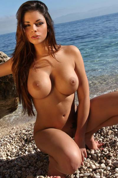 A hot day on the beach ended up in some naked tanning for the lovely Kristal Webb