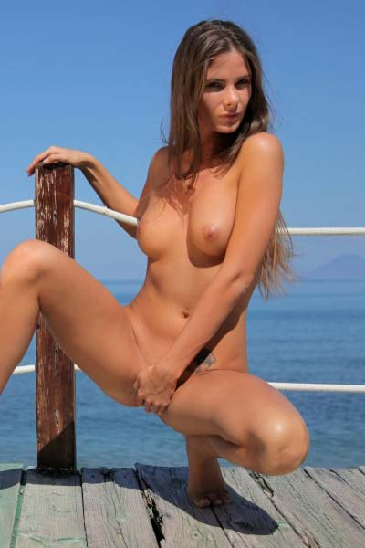 A sexy photo shoot with an amazing Juliette on the seashore terrace