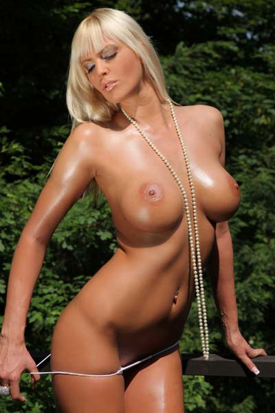 Alluring blonde with huge round boobs Amy takes everything off outdoors