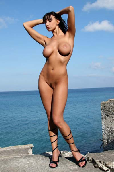 Black haired babe Marta Zawadzka gets naked easily for a photo shoot so she can show her assets