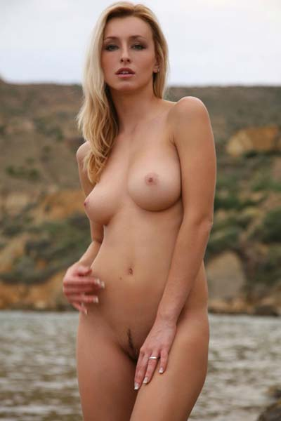 Cute and sensual girl Dominika flourishes her beautiful breasts and her tender little nipples