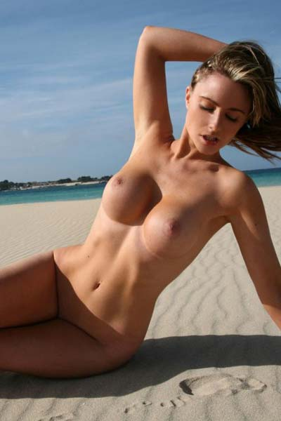 Lovely Jenna Jones does a superb job at posing naked on the beach