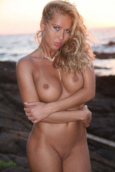 Red hot busty blonde Nicole fires up the beach with her fantastic curvy body