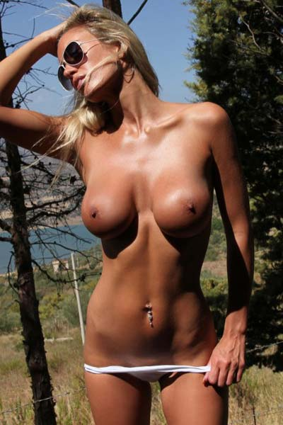 Tempting busty blonde Janine shamelessly exposes everything outdoors