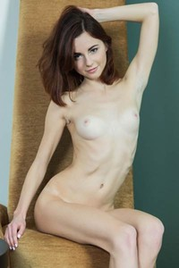 Adorable cutie Aurmi loves showing her tanlines and her slim seducing figure