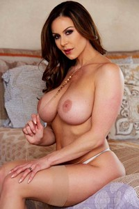 As she is slowly taking off her sexy lingerie a busty and beautiful milf Kendra Lust poses skillfully