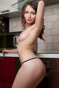 Seductive busty beauty Ynesse takes everything off slowly in the kitchen
