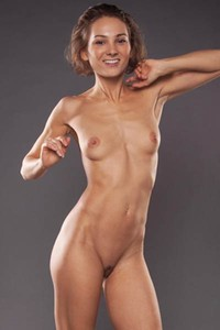 Amazing babe Sanna flaunts her fascinating naked body as she poses gracefully