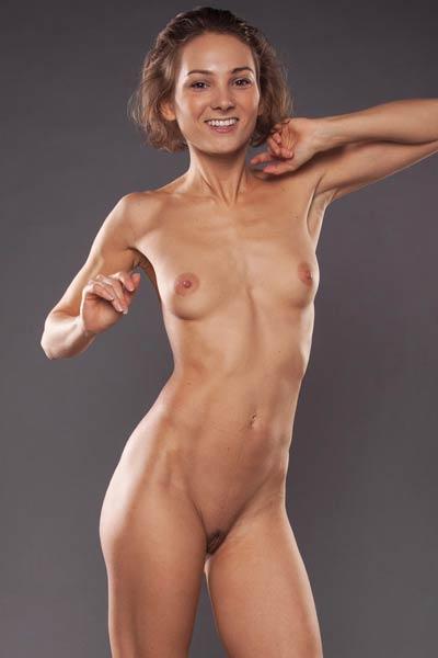 Amazing babe Sanna flaunts her fascinating naked body as she poses gracefully