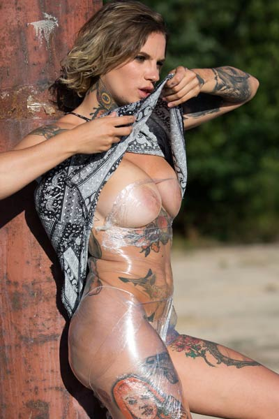 Outstanding tattooed bombshell Stacy Cloud sensually presents her perfect body outdoors