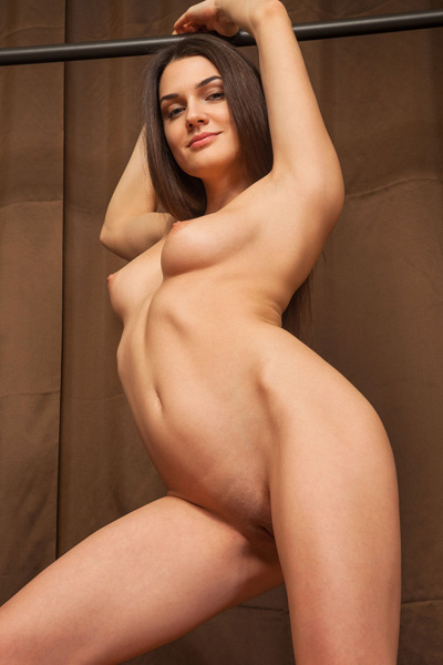 An artistic nude posing done by a perfectly shaped vixen Vanda B