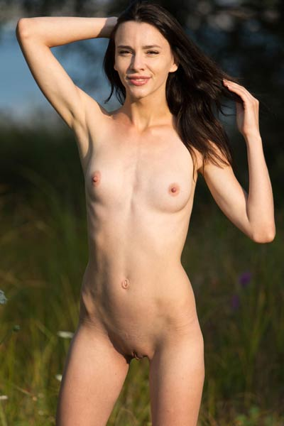 Amazing petite babe Adel Morel shows off her smooth body while poses naked in the nature