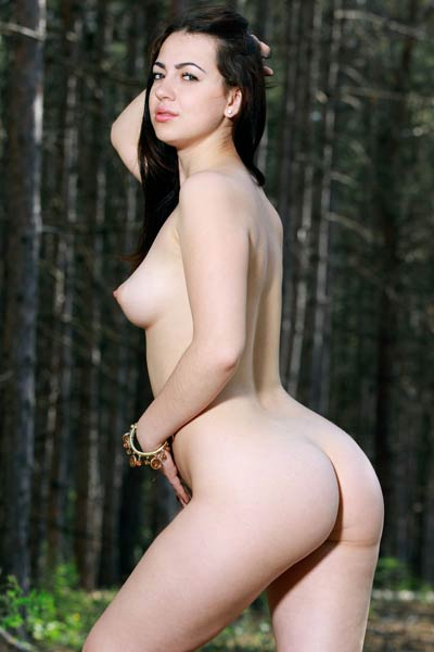 Pale skinned Sivilla strips down her see trough dress in the forest to show her nice breasts