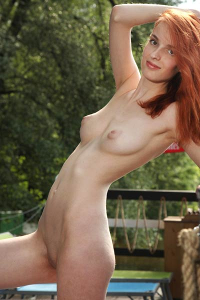 Skinny tall redhead Alisa I flaunts her perky delicious boobs with puffy niples