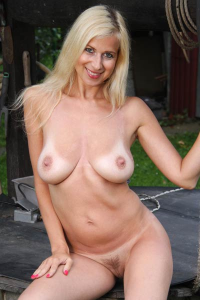 Young looking milf Anastasia Devine shows off her flirtatious tan lines and big natural breasts