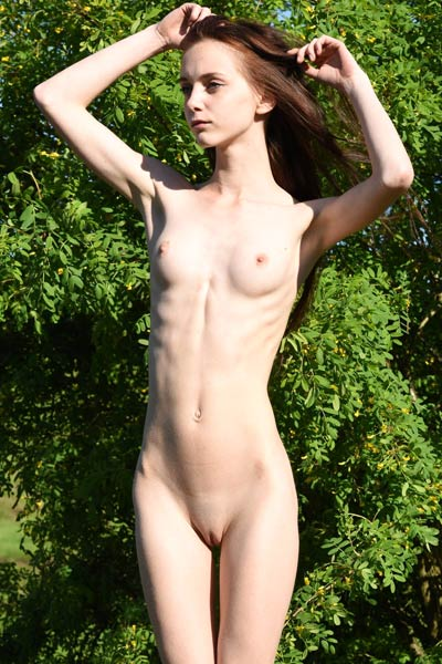 Petite and sweet Pala shows off her skinny pale body while poses naked in nature