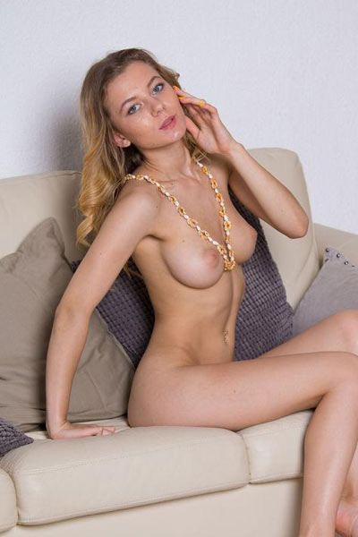 Cute and seductive Agnes takes off her yellow dress and shows off her big round tits