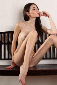 Foxy slender babe Julia P poses seductively on the bench and shows off her smooth muff