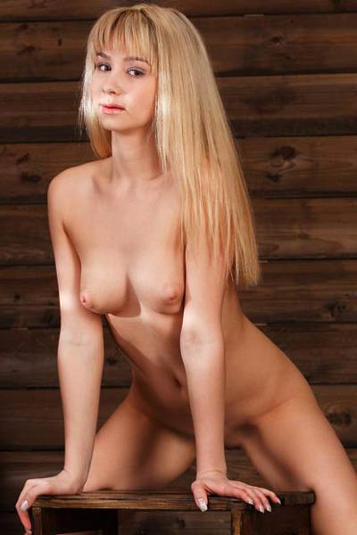 Luscious blondie Monika D gets nude in the wooden cabin and shows off her hot body