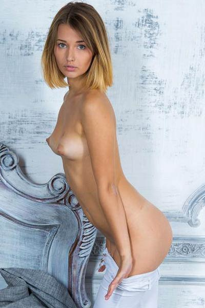 Adorable young blonde vixen strips naked and unveils her sexy naked body