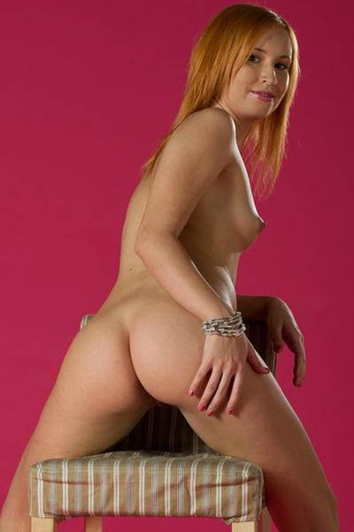 Redhead cutie shows her pale firm ass and delicious pink vag