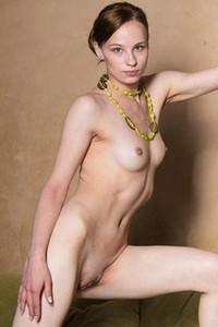 Mesmerizing angel Mia poses naked and displays her pure beauty