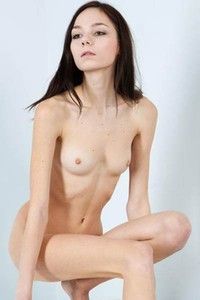 Slim dark haired babe Julia P poses on the white blocks and shows off her mesmerizing beauty