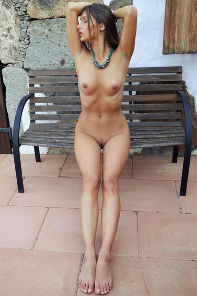 Yarina A is naked on a public bench and showing off happily