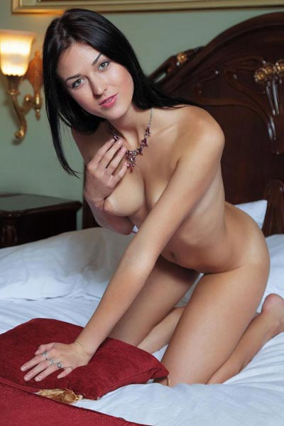 Raven haired beauty poses completely nude on her bed showing off everything