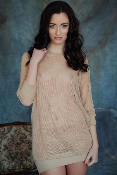 Zsanett Tomay slips off her see through shirt and opens up her long legs