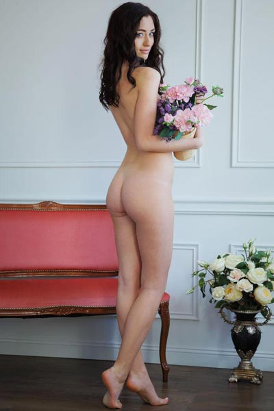 Zsanett Tomey gets flowers and strips on porch out in the open