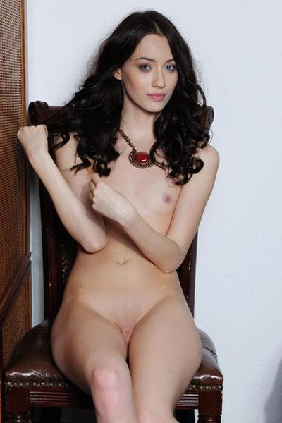Zsanett Tomay spreads her legs wide over two chairs while completely naked