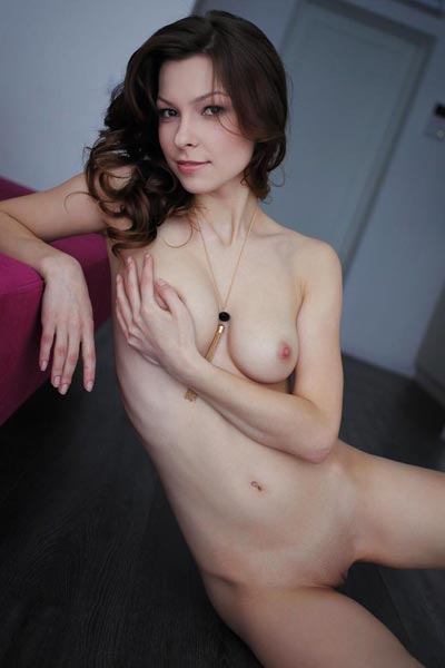 Nitsa A shows off her skinny body and small breasts by stretching